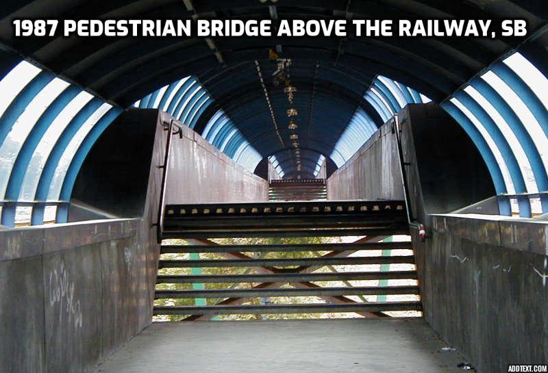 interior pedestrian bridge over train tracks