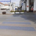 The only attractive city with 2 pedestrian crossings, white and gray and flower pots as barricades for pedestrians