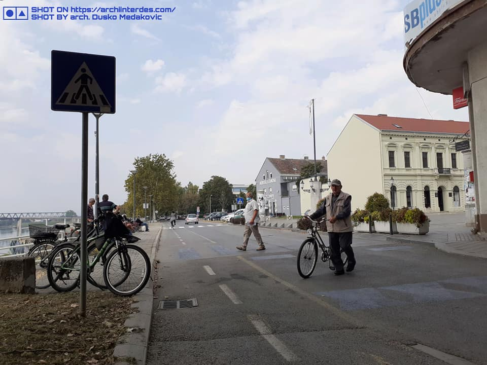 Pedestrians-cyclists-over-old-gray-pedestrian-crossing