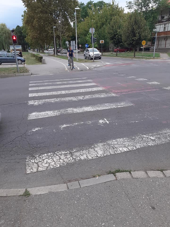 worn-out-pedestrian-bicycle-crossing-the-road