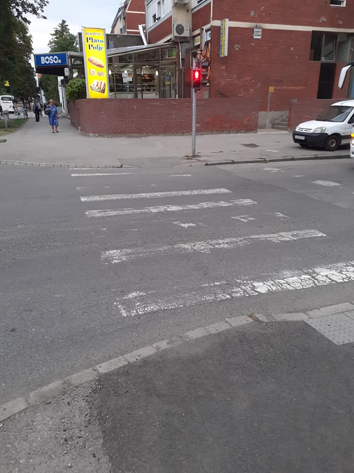 worn-out-pedestrian-crossing-the-road